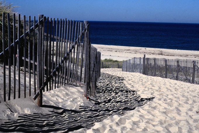 Fence across the sand dunes at Race Point Beach, part of the Cape Cod National Seashore, near Provincetown - Cape Cod, Massachusetts