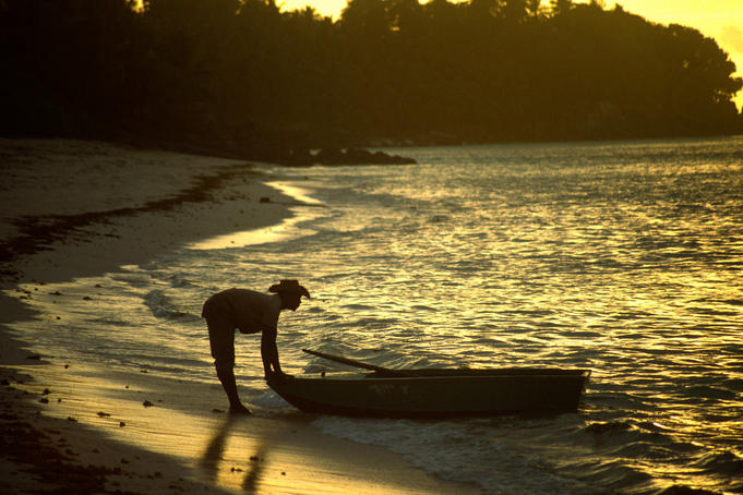 Man going fishing at dawn, Anse Royale.
