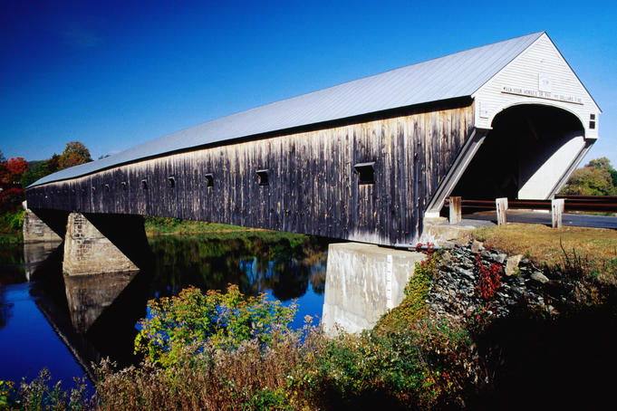Cornish covered bridge over river.