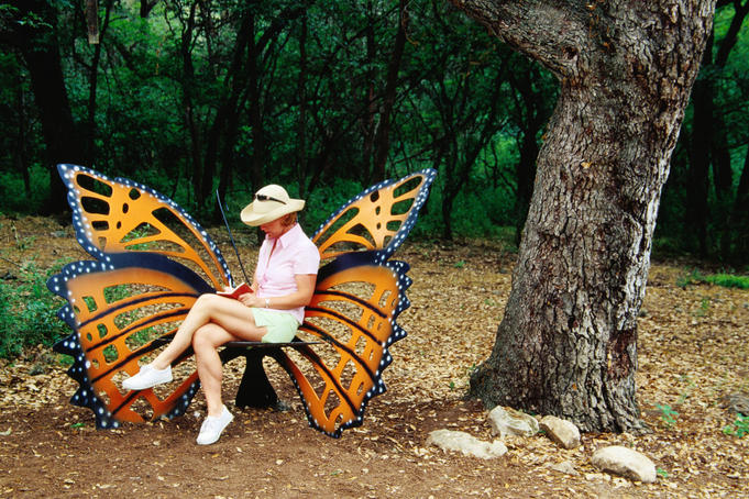 Woman sitting in butterfly chair at Botanical Gardens, Zilker Park.
