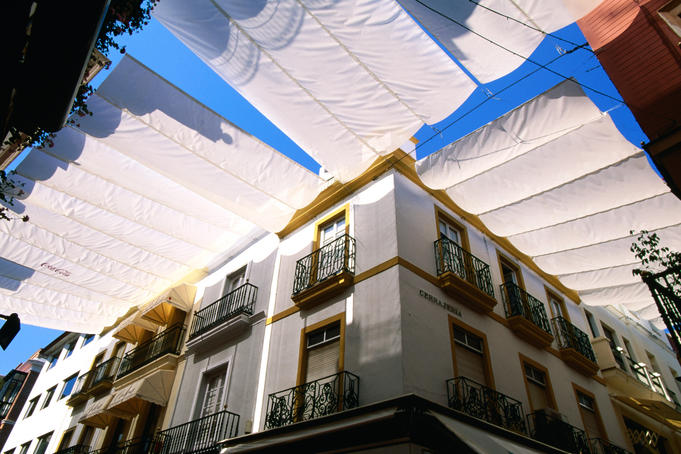 Awnings over Calle Sierpes street.