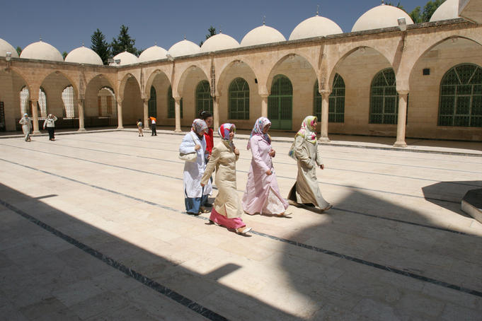Group of young Turkish women walking through colonnaded courtyard of Hazreti Ibrahim Halilullah.
