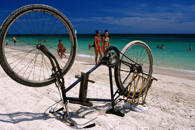 Upturned bike on beach.