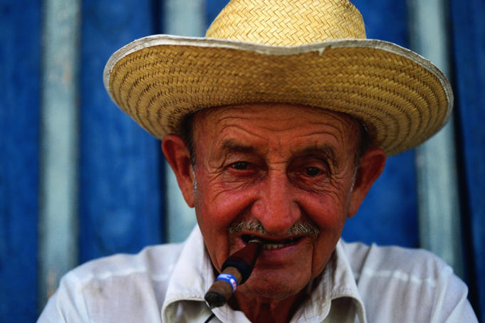 Man smoking cigar.