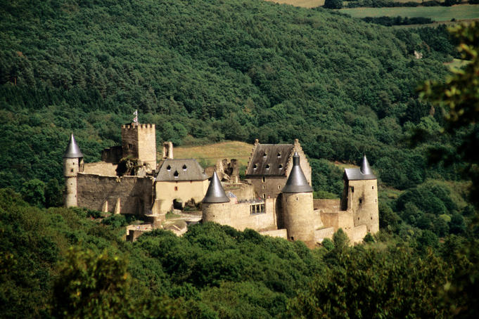 Castle set amongst forested slopes in Luxembourg Ardennes.