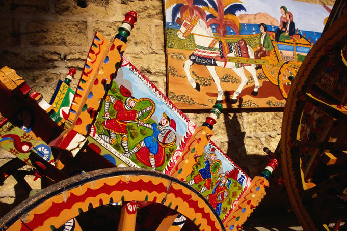Traditional craftwork on decorated cart.