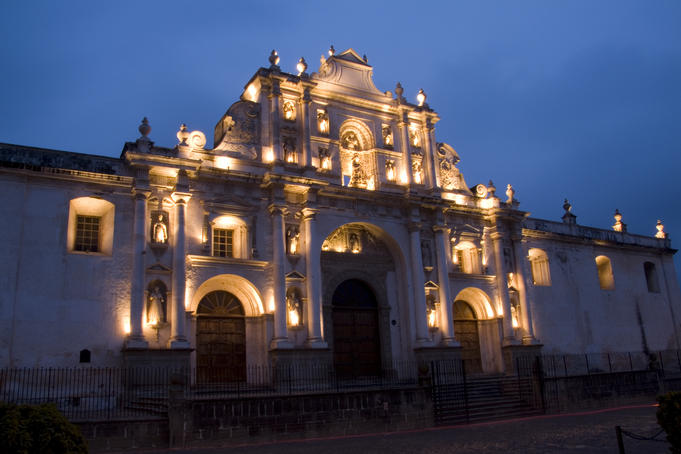 Facade of Cathedral de Santiago lit up at night.