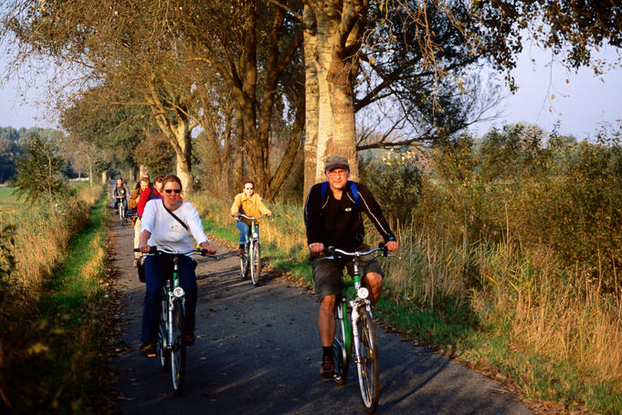 People cycling along bicycle trail on outskirts of Bremen.