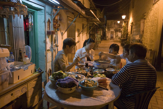 Family dining outside in Old Taipa.