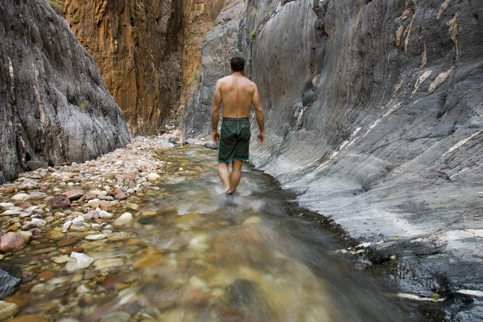 Rafter explores Clear Creek, Colorado River.
