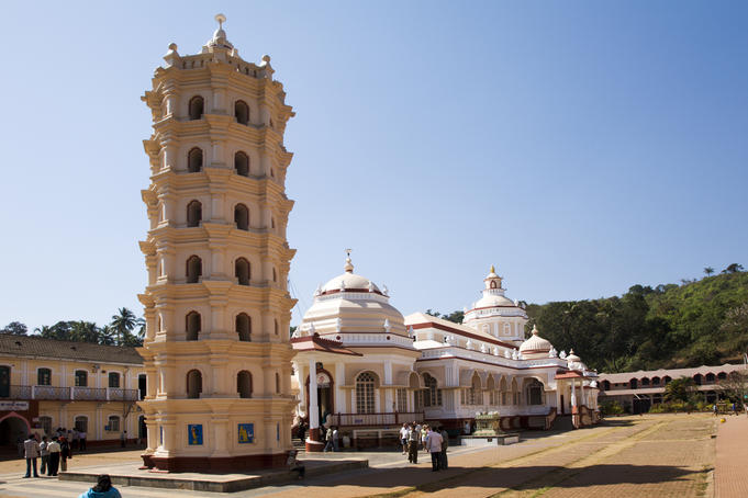 "Sri Manguesh temple and lamp tower called ""Deep Stambha""."