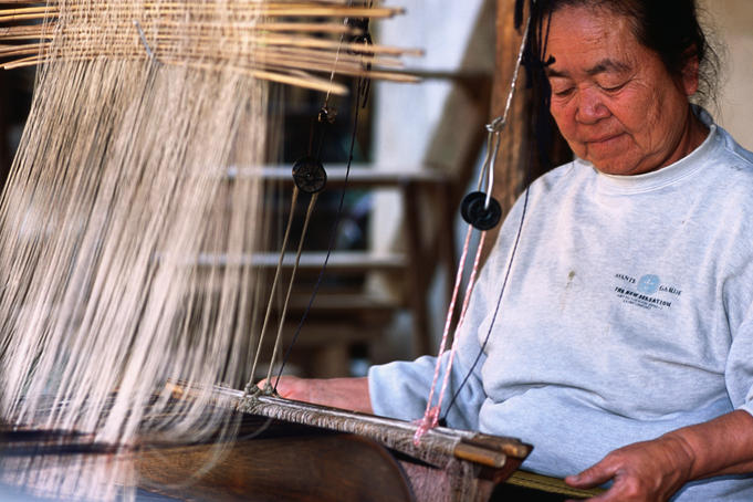 Woman at weaving loom in Baan Phanon village.