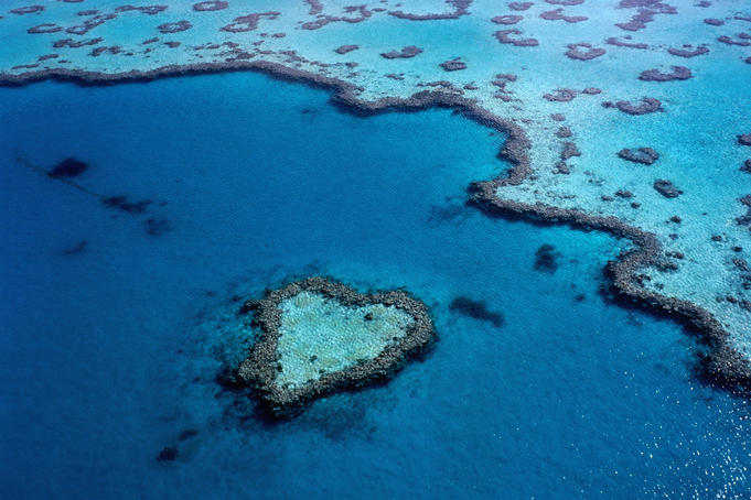 Aerial of heart-shaped reef at Hardy Reef, near Whitsunday Islands, Queensland.