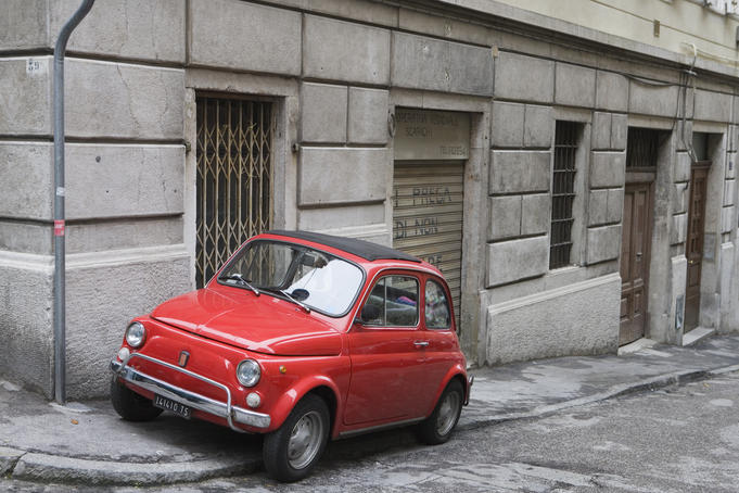 Adorable little Fiat Bambino brightening the back streets of Siena.