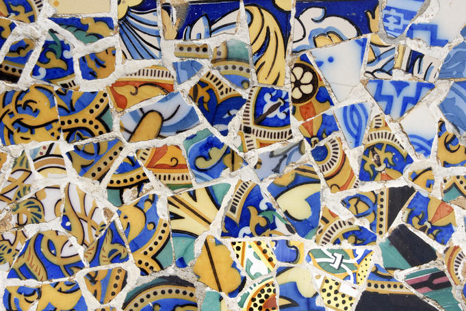 Detail of Banc de Trencadis - a curved tiled bench on Sala Hipostila, Parc Guell.