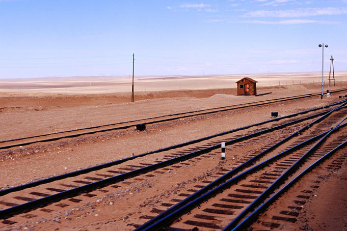 Train tracks and barren countryside from Trans-Mongolian train.
