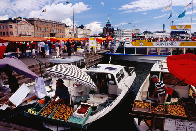 Selling fruit and vegetables from boats, kauppatori (fish market) on the harbour.