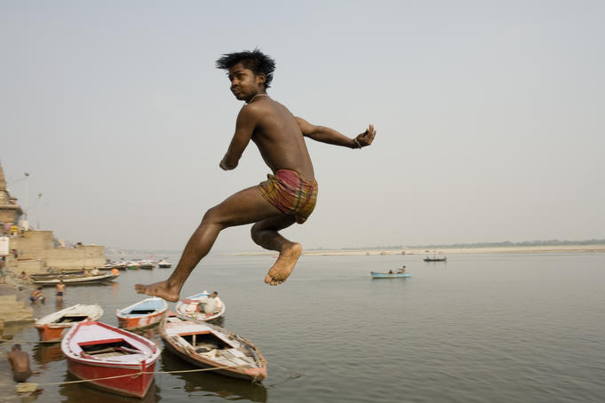 Boy jumping into Ganges.