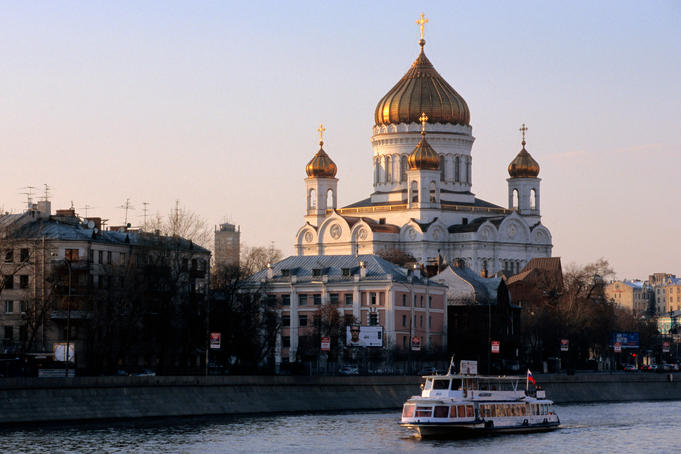 Moscow River cruise boat passing Cathedral of Christ the Saviour.