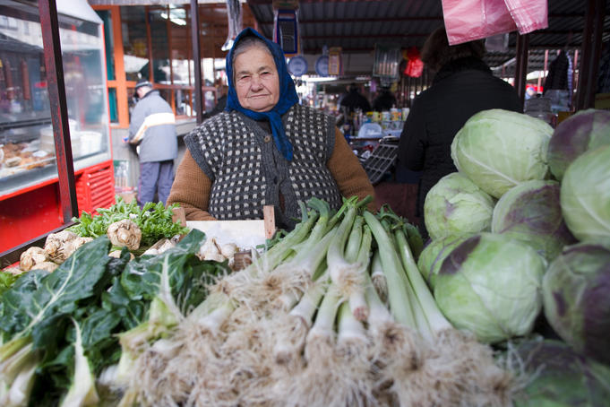 Woman selling leeks, cabbages and silver beet at Green Market, Central Belgrade.