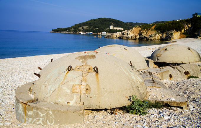 Bunkers on beach at resort town of Himara.