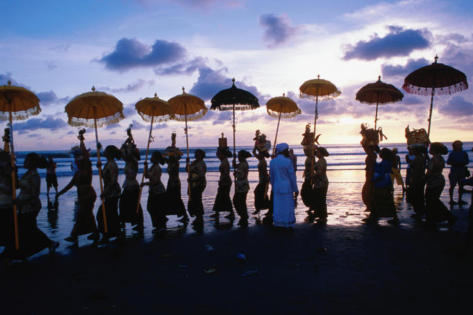 Melasti ceremony on Kuta Beach celebrating Balinese New Year.