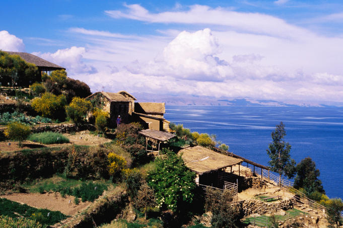 Thatched houses and garden plots above Lake Titicaca.