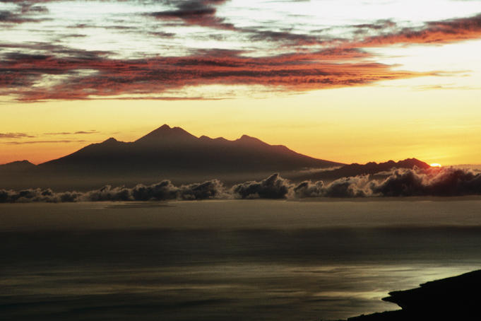 Lombok at sunrise from summit of Gunung Agung.