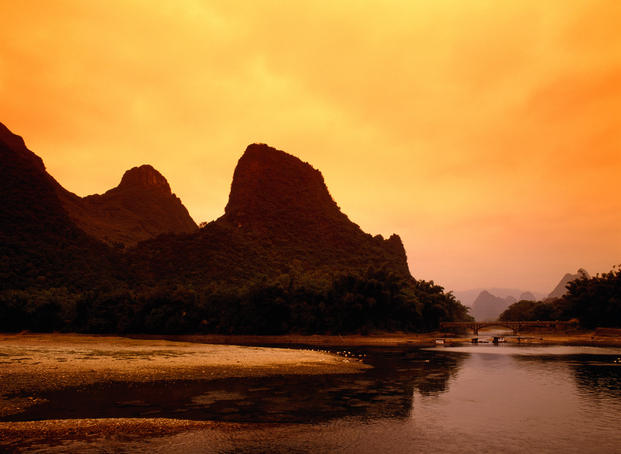 Li River with mountains in distance.