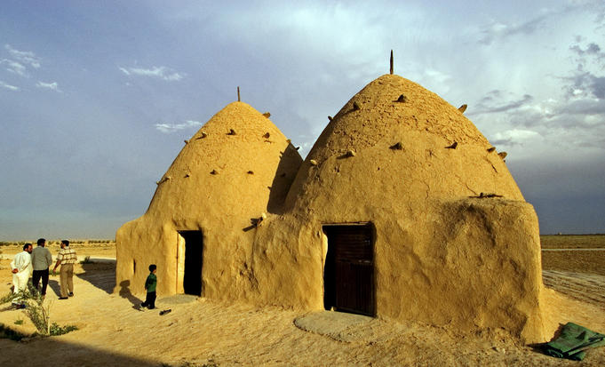 Conical mud-brick beehive houses, central Syria.