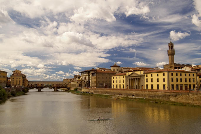 Rowers on River Arno with Ponte Vecchio in background.