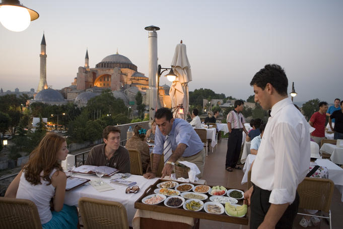 Dining at Balikci Sabahattin Fish Restaurant in Sultanhamet, with Aya Sofya in background.