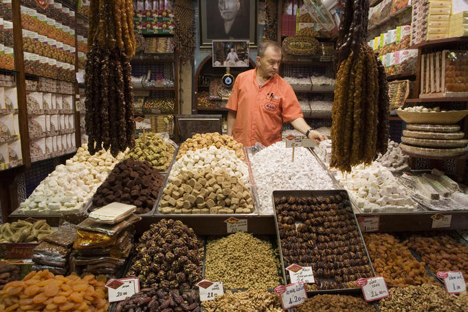 Selling Turkish delights, dried fruits and nuts.
