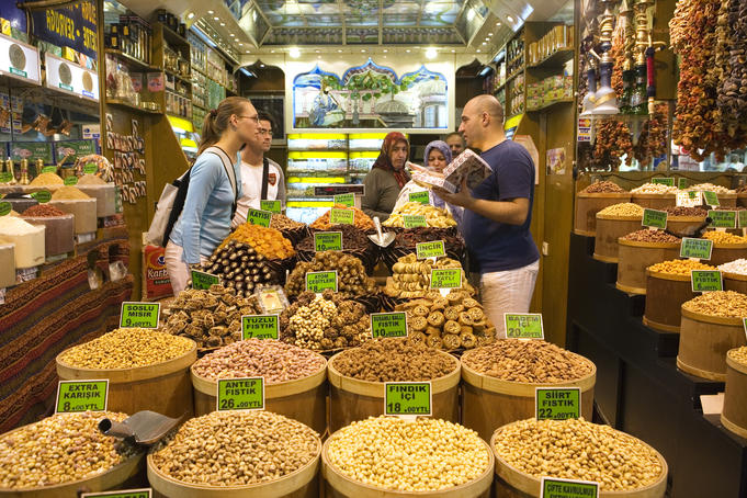 Tourists buying nuts at Misir Carsisi Spice Bazaar.