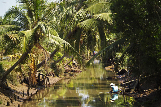 Typical river scene in Mekong Delta.