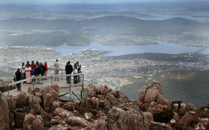 Tour group being photographed on top of Mount Wellington.