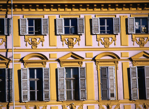 Shuttered windows on the decorative facade of the Piazza San Carlo