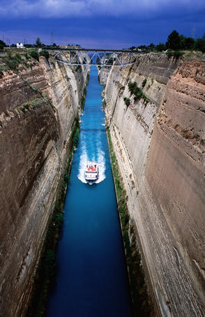 Boat cruising through Corinth Canal.