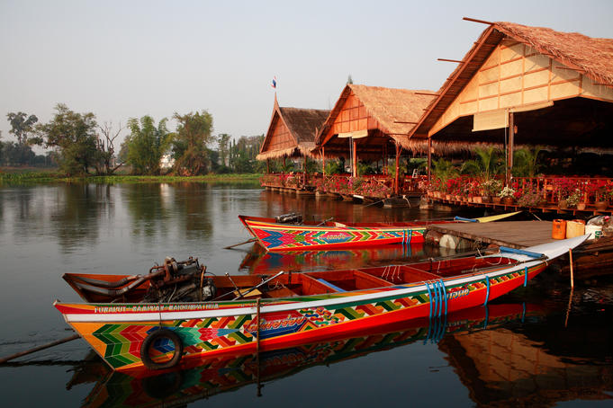 Long-tail boats and restaurants on River Kwai.