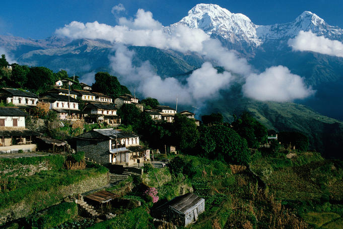 Village with Annapurna South and Hiunchuli in background.