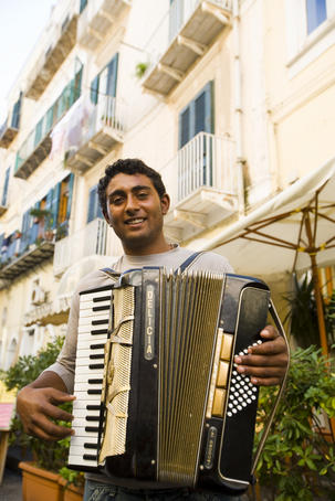 Musician playing accordion in Ischia Ponte.