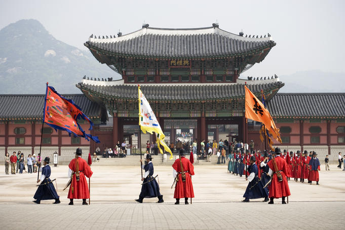 Ceremonial Guards and tourists outside the entrance to Gyeongbokgung Palace.