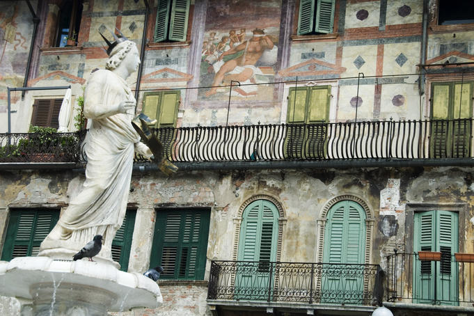Statue of Madonna of Verona and facade of Casa Mazzanti.