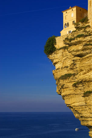 House hanging precariously on edge of cliff.