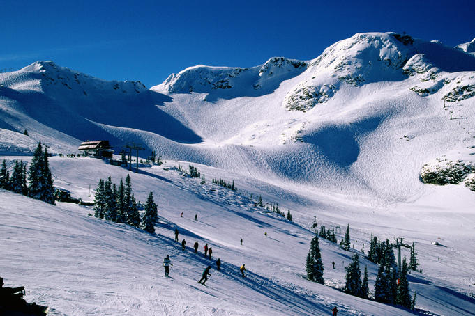 Skiers on the high ski slopes of Whistler Mountain, Coast Mountains.