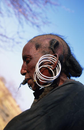 Portrait of woman of Wodaabe (aka Peul, Bororo, Fulani) tribe wearing earrings, near Agadez in Sahel region.