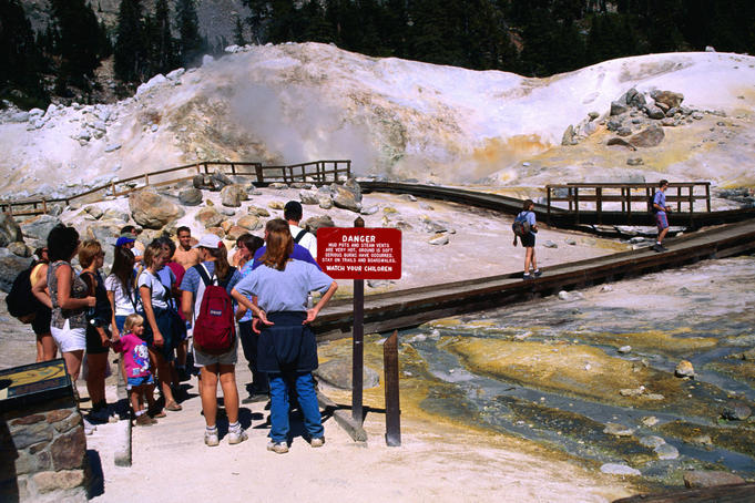 Visitors on the boardwalk at Bumpass Hell, a geothermal area of Lassen National Park - Cascade Range, Northern California