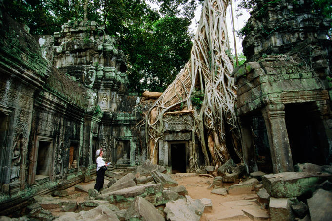 Tourist at Ta Prohm temple.