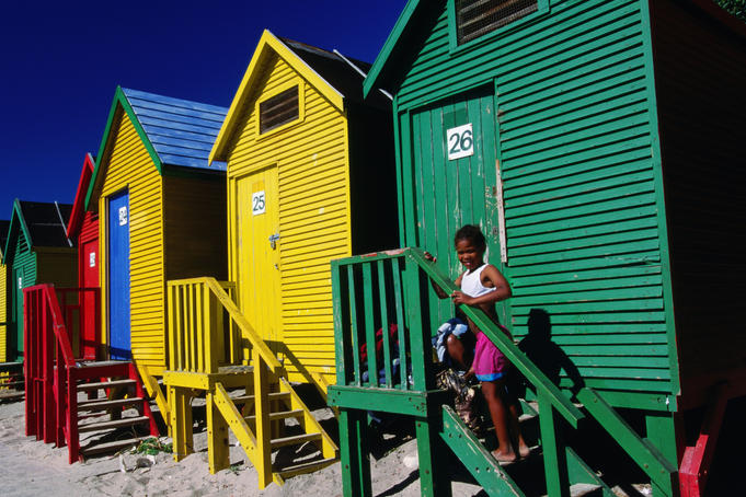Girl and bathing huts, Muizenberg Beach.
