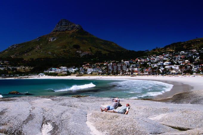 Sunbathers with Clifton Bay in background.